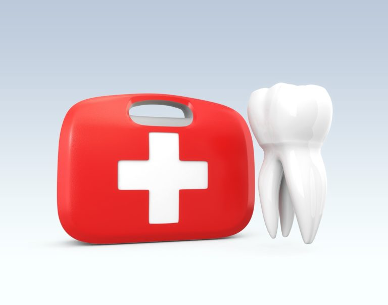 A red first aid kit next to a white tooth